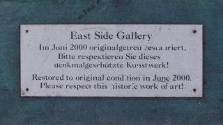 East Side Gallery - Plaque with notice about restoration