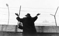 Woman waving over the Berlin Wall in 1961