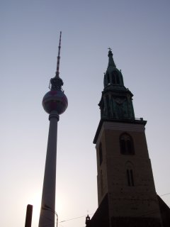 The St. Marienkirche dwarfed by the Television Tower